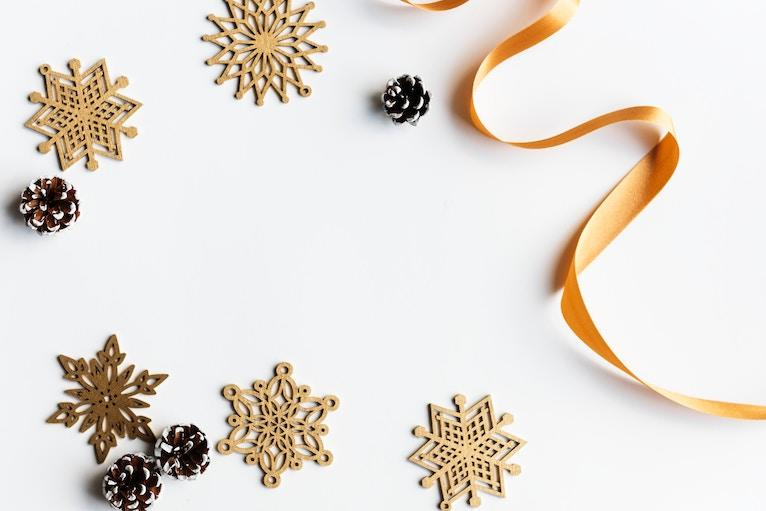 Gold snowflakes and ribbon on a white background
