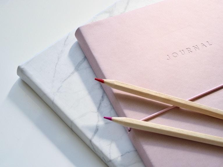 Colored pencils and journals