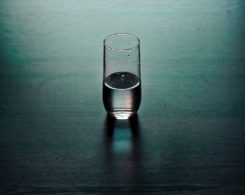 Glass of water on a dark table
