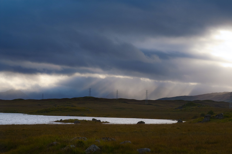 Sunlight through clouds over the Scottish moor